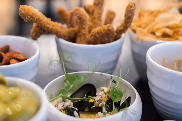 crispy pigs ears / mussels / gordal olives / parsnip crisps / smoked almonds