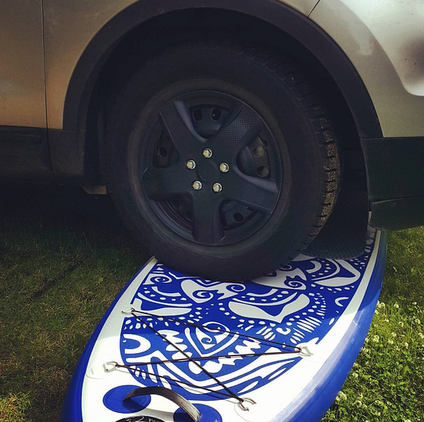car parked on an inflatable paddleboard. Best paddleboard, indestructible