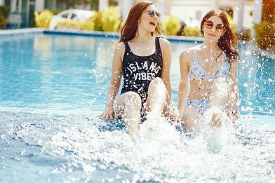 two-girls-laughing-having-fun-by-pool_ed
