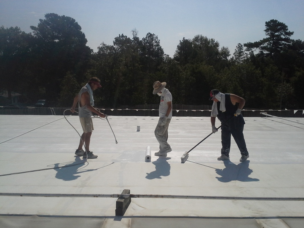 Contractors Applying Our Coating Application