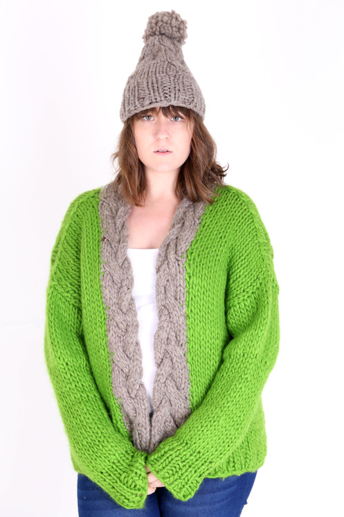 73229a06443e55 This cosy, chunky unisex cardigan is hand-knitted using a bright, grass green  Merino wool and an undyed British Blue-Faced Leicester wool.