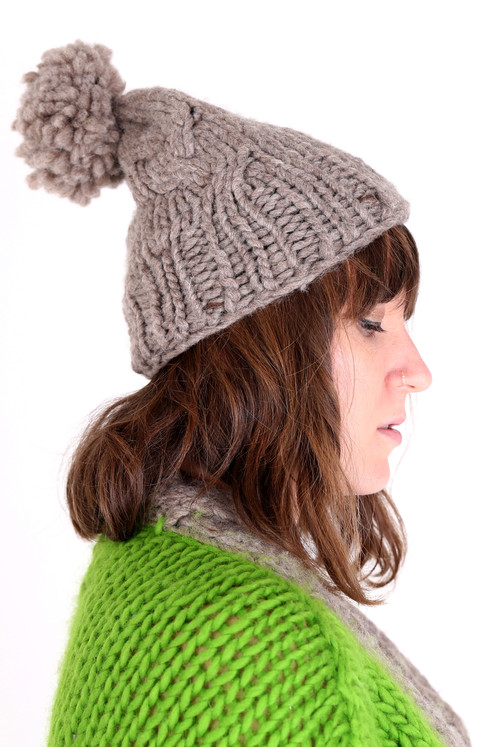 081b1136ce7 This chunky pom pom hat is hand knitted using 100% undyed
