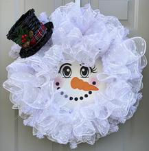 Snowman with metal face.jpg