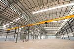 Indoor empty warehouse factory and crane