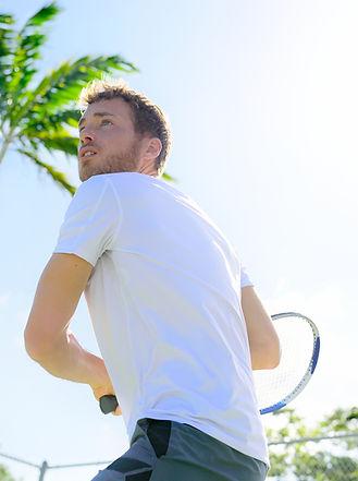 bigstock-Male-tennis-player-finishing-s-