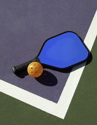 bigstock-Pickleball-and-Paddle-On-Edge--