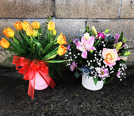 One Dozen Tulips in a Decorative Vase (Left) Lillies, Daises, Roses & Thistle in a Stamped Ceramic Vase (Right)