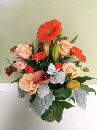 Shades of Orange in Clear Vase