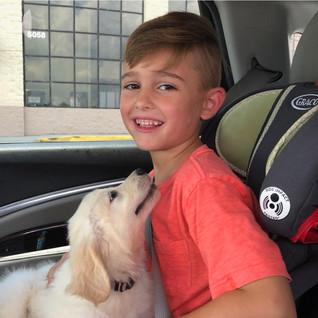 Puppy going home w_ kid.001.jpeg