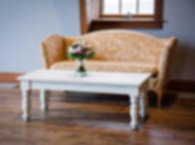 orange sofa with distressed coffee table