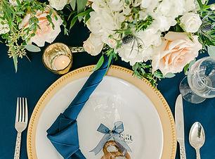 gold beaded charger blue napkin.jpg