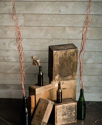 wood boxes display with bottles.jpg