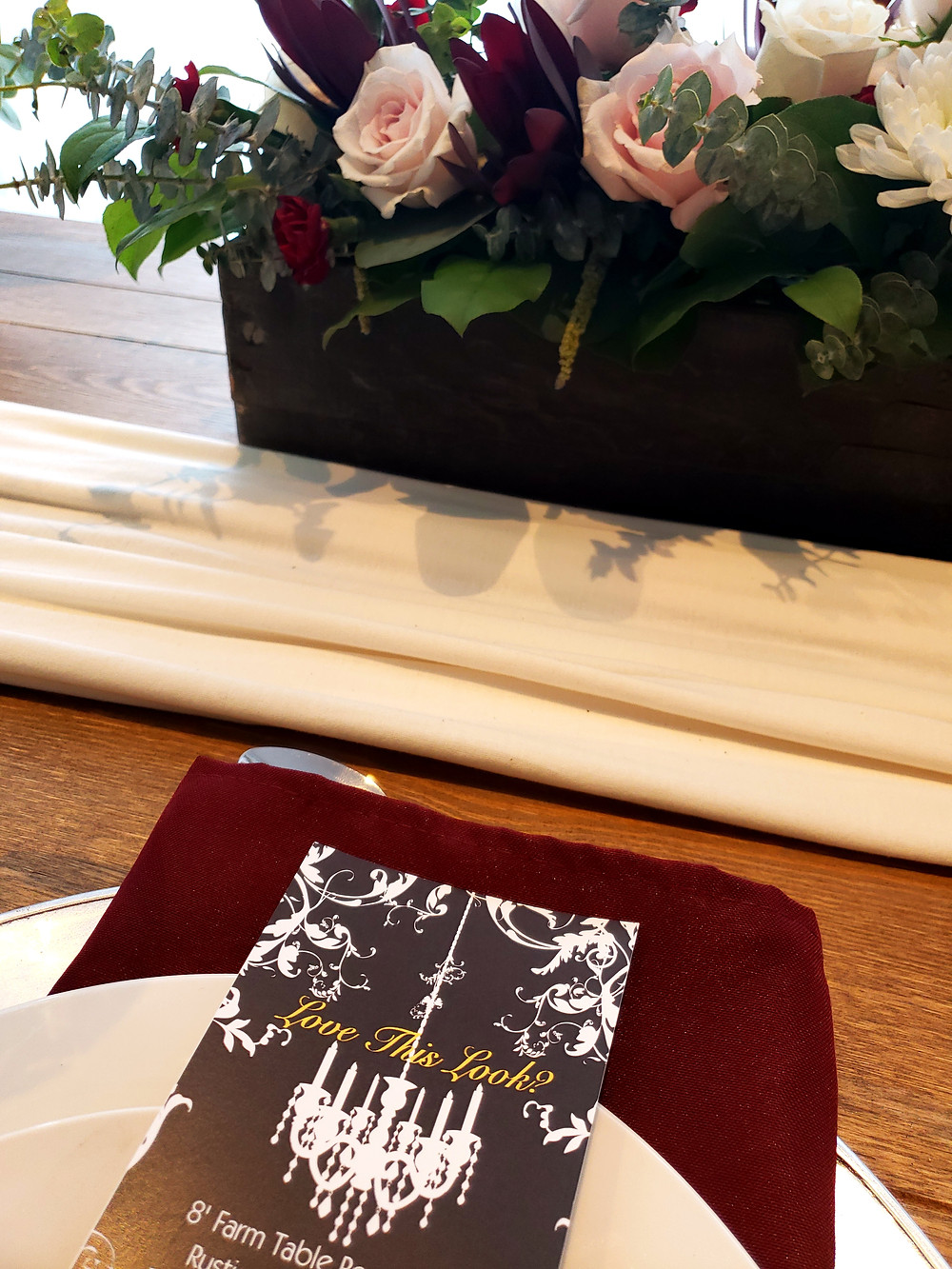 Our super soft cotton linens look fantastic down the center of our farm tables. Add one of our rustic boxes atop and add some silver vintage charger plates and burgundy and you've got it!