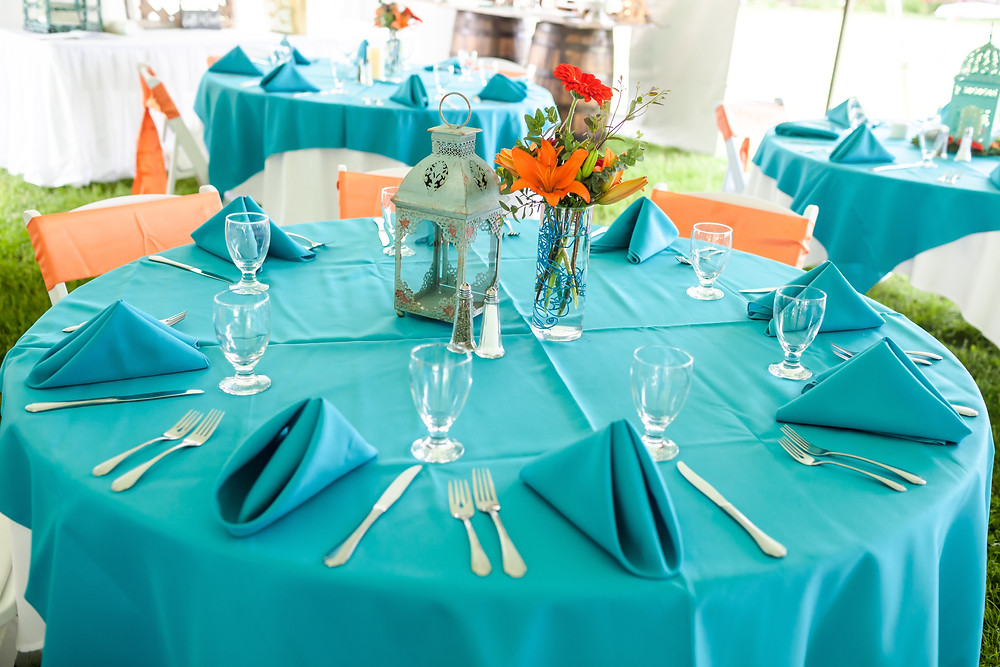 At this beautiful beach wedding, linens were turquoise and they just popped!