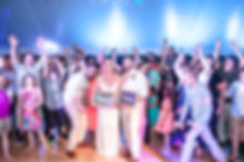 Packed dance floor for a tent wedding in Petoskey