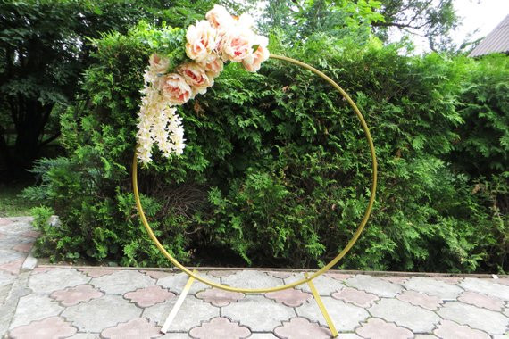 "We are creating and building a circle arch for rent! It will be approximately 80"" tall and perfect for the two of you (and perhaps your officiant) to stand under. Look for it soon!"