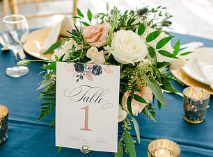 table numbers in gold spiral.jpg