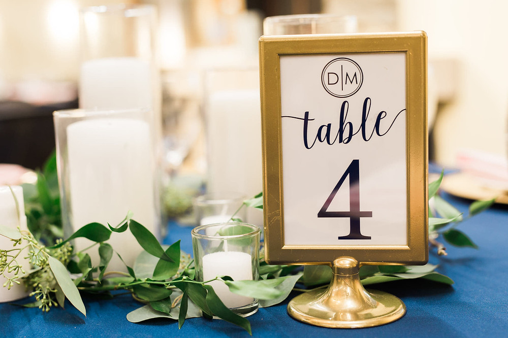 This customized frame from Ikea was primed and painted gold to match our couples' navy, blush and gold wedding