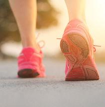 athlete-woman-walking-exercise-on-rural-