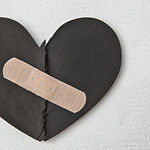 Two parts of red broken wooden heart tap