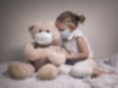 Little girl and big plush bear in medica