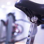 Spinning cycling class exercise bike in
