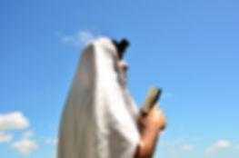 A Jewish man wearing Tallit and Tefillin