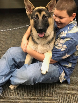 SACA Student Ben with a Dog the Sanctuary Project had just rescued from Death Row.