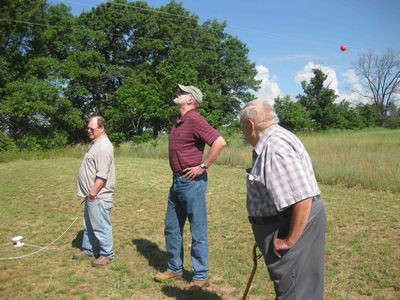 Mike Pagel (Amherst), Mike Gorniak (Minnesota), and Art Wysocki(Stevens Point) watch as one antenna is put in place.