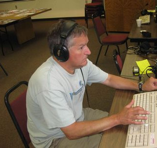 Scott Jasper of Plover operates the code station, using the keyboard to generate Morse code.
