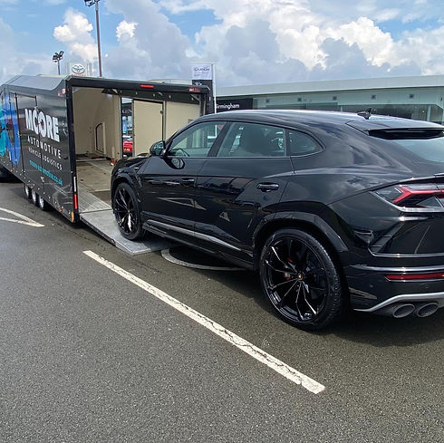 A car using our enclosed vehicle transport trailer