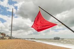 Blowing on Brighton Beach