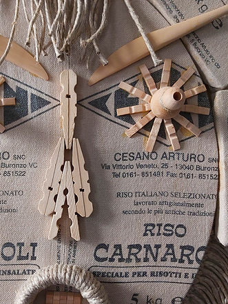 Risotto  Mask in bags of recycled Italian rice Varnarolli, sewn and assembled onframes, adorned with Beaux-Arts wooden utensils and wooden clothespins, trimmed with loose braids in string.