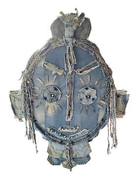 Jean Genie Denim mask, metal buttons, fragments and offcuts of jeans, assembled and sewn, frayed and braided.