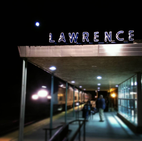 """Favorite Signs of #LFK, No. 11: Lawrence Train Depot, or This Way to Albuquerque. The Southwest Chief stops here twice a day on its way to Los Angeles or Chicago, in case you feel like a little Cary Grant in """"North by Northwest"""" role-playing. This would be the night train headed west, which I hear is a pretty scenic trip if you can handle 36 straight hours on a train."""