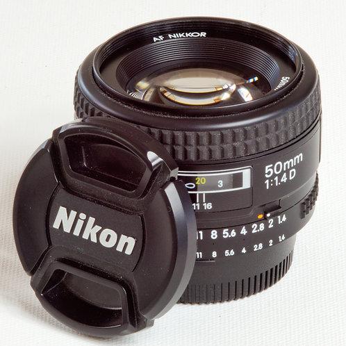 Nikkor AFD 50mm F1.4 prime lens with lens caps