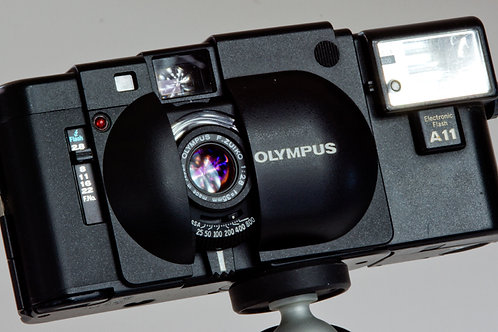 Olympus XA 35mm rangefinder with A11 flash, instructions and box front view