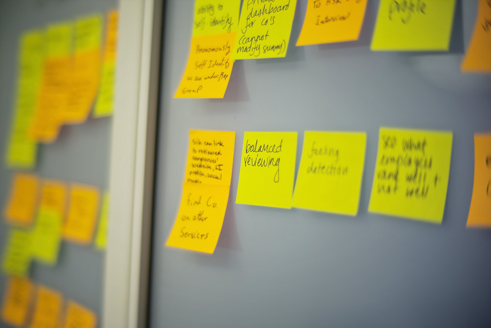 Wall of yellow post it notes from a design sprint