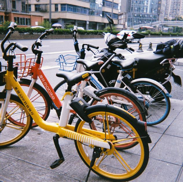 3 different colored bikes