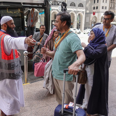 Hussain (Advance Team) directs Hujjaj to the hotel lobby upon their arrival to Madinah.