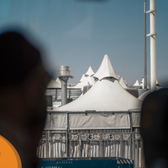 The group was taken by the Mina tents.