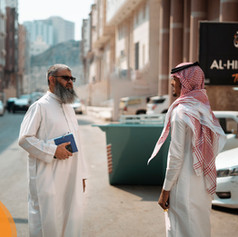 Mohammed Saeed (Advance Team Leader) speaks with a member of the Saudi team to check all arrangements in the Shisha building are in place.