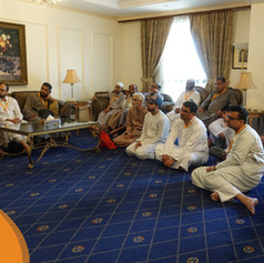 A group sit attentively through their religious session.