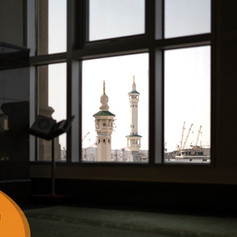 The minarets of the Haram peeking through the windows of the Swissotel prayer room
