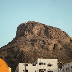 Jabal Noor pictured from below. Visible towards the right of the frame is a faint white zig-zag of Hujjaj from all over the world making their ascent to Cave Hira at the very top.