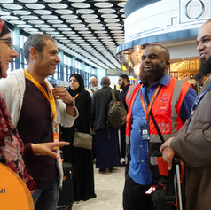 Pilgrims meet brother Jafar (2 Week Deluxe Group Leader) and Shaykh Ahsan Hanif (Religious Guide) at the airport, ready to set off on their journey.