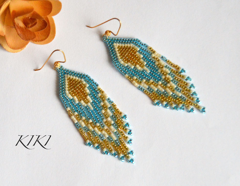 Golden green long earrings