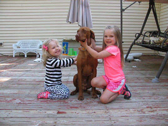 Two young girls showing no fear of Ruger.