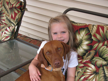 Girl holding gentle Ruger.
