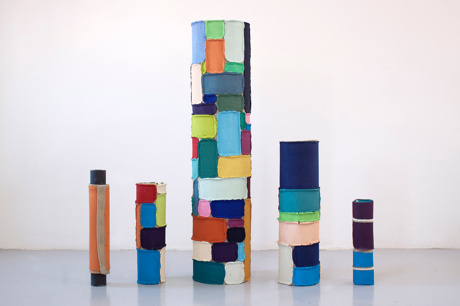 Totems, 2019. Acrylic, sand, limestone and linen. Variable measures.